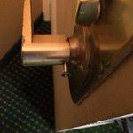 screw coming out of inside door knob