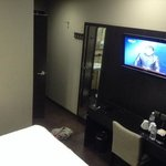 hanging flat TV and fullbody mirror at superior room #505