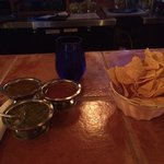 Chips with 3 salsa's - green tomatilla, chipolte, red chile. Hot!