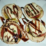 a fabulous appitiser of balsamic reduction, roast tomato and local cheese on a pita