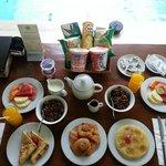 Huge breakfast spread in villa.