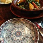 lamb tagine and couscous served on beautiful plates