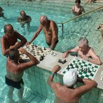 Chess in thermal swimming pool 38°
