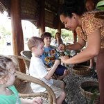 Hands on demonstration making toys from palm leaves