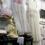 Vintage / antique dresses hanging on the wall
