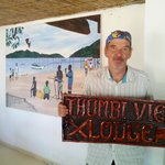 Doc Bob with the Thumbi View Lodge sign. From the dining area