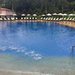 Pool with warm water--it had just rained for 10 min so no one out--but chairs are plentiful