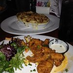 Buffalo frog legs with a side of mac and cheese.
