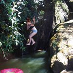 Jumping in the natural pool.