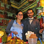 Fatima and the owner of an olive shop