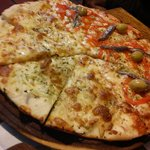 our selection of pizza half anchovies half onions
