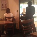 Manageress doing her admin work while customers are right next to her