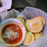 Friied ravioli with sauce---cheese filled, tasty