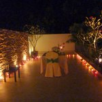 Candlelit meal above the pool