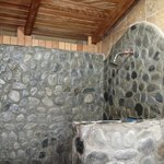 The shower is made of chunky stone. Awesome!