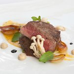 """Aus. Beef """"Tournedos"""" with béarnaise sauce, caramelized onions and roster garlic puree"""