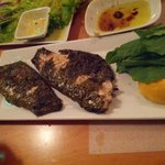 Vine-wrapped sea bass
