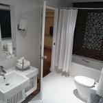 Large spacious attractive main bathroom (with one light not working and used towel not removed b