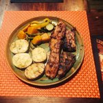 Grilled ribs , jacket potatoes and grilled vegetables . @ Fred's bar and grill