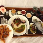 Room Service: Oysters, Fries, and Pork Chop from Urban Farmer