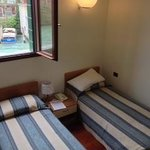small room, with 2 single beds, overlooking the canal