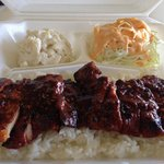 Spicy chicken with cabbage salad and macaroni salad.