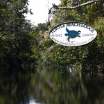 River sign to Turtle Beach Lodge