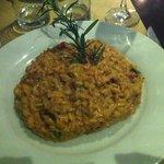 Risotto de tomates secos, rucula y queso provolone