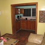 full kitchen, full fridge, sink, dishes