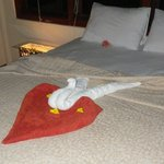 towel swan and flowers on the bed