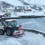 Keeping the road cleared by a snowplough near the cabins