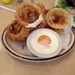 Yum onion rings with ranch and chipotle dip.