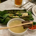 Bake rice in banana leaves and beef