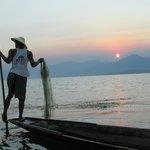 One leg fisherman at Inle Lake in twilight.