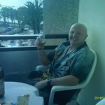 my friend barney sitting having a drink on the balcony