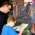 Father and son having fun on a scavenger hunt in the Exhibit Room!!