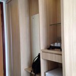 Wardrobe with safety box and complimentary drinks and water heater