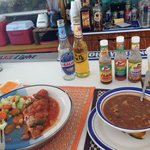 Breakfast at Fish Fry. Conch soup and stew fish