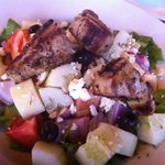 Greek salad with fish but meanger meshed feta cheese