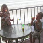 Blowing bubbles on the balcony
