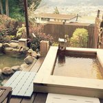private onsen bath in your own room with city and mountain view