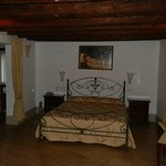 The main bedroom with thick wooden beams on its roof make it very cosy and authentic