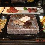 food cooking on black rock