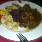 Wild goulash with red cabbage and dumplings