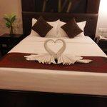 Queen bed with towel art