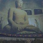 Buddha poster on the mountain