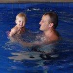 enjoying a swim in the pool.