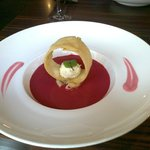 Paneer truffle, naan, potato cake, with beetroot and coconut sauce.