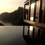 your private infinity pool and villa hovering above the trees