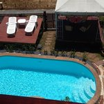 Pool, outdoor table and loungers
